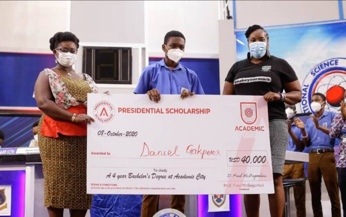 Dr. Lucy Agyepong (right) and Ms. Shannan Akosua Magee of Academic City presenting the scholarship to Mr. Daniel Kekeli Gakpetor (middle)