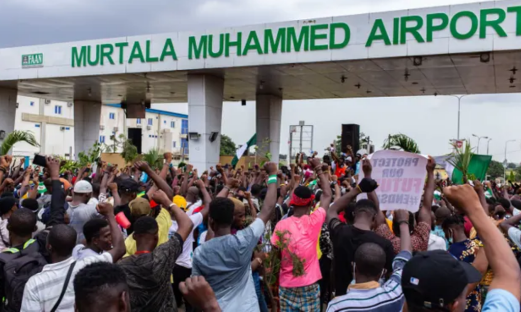 A one-minute silence on Monday among the crowds near Murtala Muhammed airport, Lagos, to remember 'lives lost to police brutality'. Photograph: Benson Ibeabuchi/AFP/Getty
