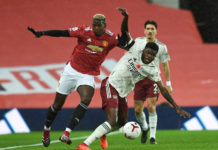 Partey battles Pogba at Old Trafford