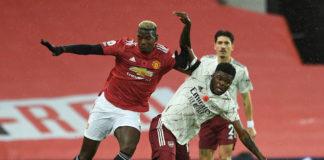 Partey battles Pogba at Old Trafford