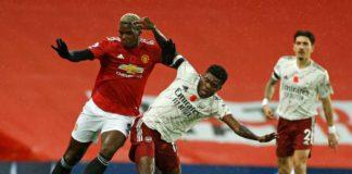 Thomas Partey tackles Pogba
