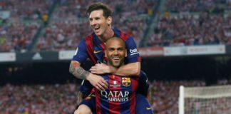Dani Alves celebrates with Lionel Messi