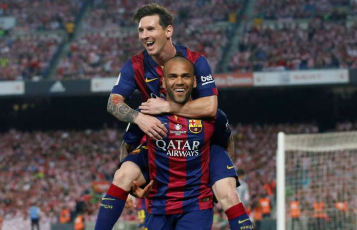 Dani Alves celebrates with Lionel Messi