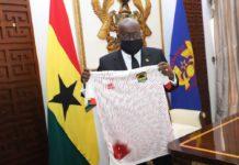 President Akufo Addo with new Asante Kotoko Errea jersey