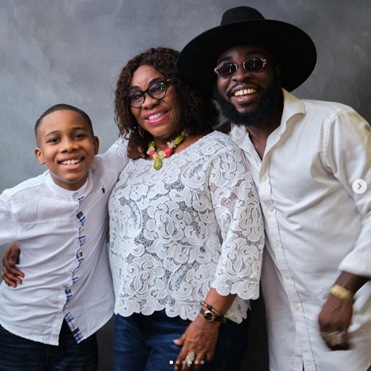 M.anifest and mother in family photo