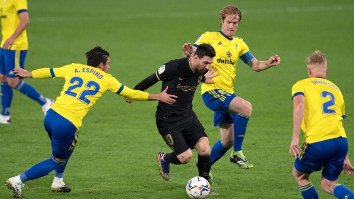 Cadiz players surround Lionel Messi Image credit: Getty Images