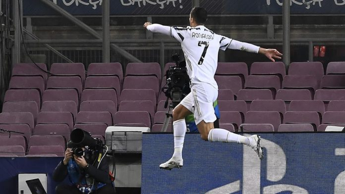 Juventus' Portuguese forward Cristiano Ronaldo celebrates after scoring a goal during the UEFA Champions League group G football match between Barcelona and Juventus at the Camp Nou stadium in Barcelona on December 8, 2020. Image credit: Getty Images