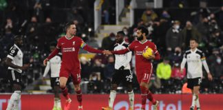 Liverpool's Egyptian midfielder Mohamed Salah (2nd R) celebrates with Liverpool's English midfielder Jordan Henderson after scoring their first goal from the penalty spot during the English Premier League football match between Fulham and Liverpool at Cra Image credit: Getty Images