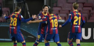 Barcelona's Spanish defender Jordi Alba celebrates his goal with Barcelona's Argentinian forward Lionel Messi during the Spanish league football match between FC Barcelona and Real Sociedad at the Camp Nou stadium in Barcelona on December 16, 2020. Image credit: Getty Images