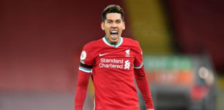 Liverpool's Brazilian midfielder Roberto Firmino celebrates scoring his team's second goal during the English Premier League football match between Liverpool and Tottenham Hotspur at Anfield in Liverpool, north west England on December 16, 2020. Image credit: Getty Images