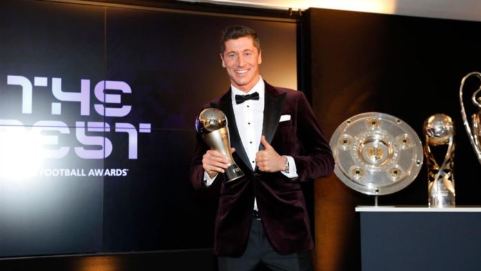 Robert Lewandowski of FC Bayern Muenchen poses after winning the FIFA Men's Player 2020 trophy during the FIFA The BEST Awards ceremony on December 17, 2020 in Munich, Germany. Image credit: Getty Images