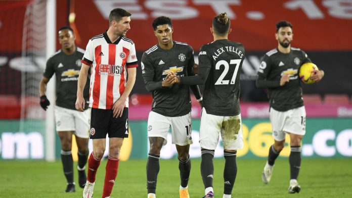 Marcus Rashford of Manchester United celebrates with team mate Alex Telles after scoring their sides first goal during the Premier League match between Sheffield United and Manchester United at Bramall Lane Image credit: Getty Images