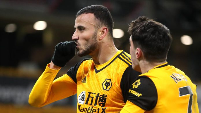 Romain Saiss of Wolverhampton Wanderers celebrates with teammate Pedro Neto after scoring their team's first goal during the Premier League match between Wolverhampton Wanderers and Tottenham Hotspur Image credit: Getty Images