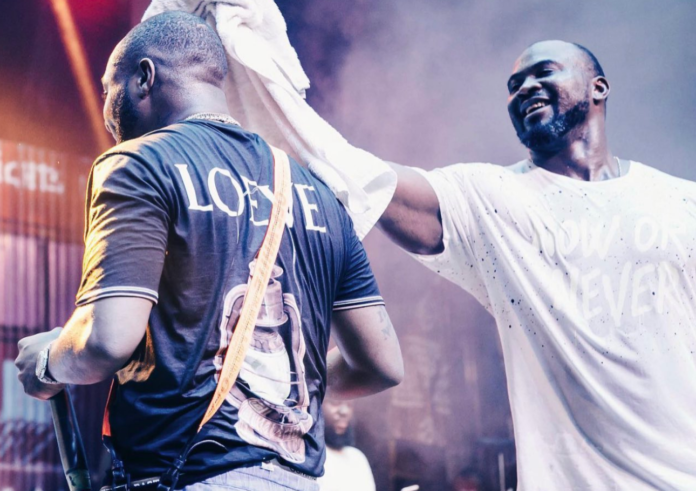 Davido's fallen bodyguard TJ wipes sweat off the musician during performance