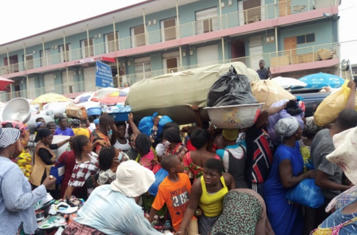 Shoppers on the street in front of the Makola Market in Accra.