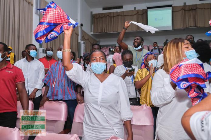 Lydia Alhassan waves an NPP flag to signify victory after she floored John Dumelo at Ayawaso West Wuogon