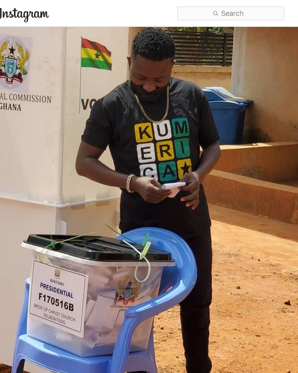 Gospel musician Brother Sammy dons his Kumerica shirt to vote at Bride of Christ Church, Asubonteng