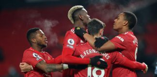 Manchester United's Portuguese midfielder Bruno Fernandes (C) celebrates with teammates after scoring their second goal from the penalty spot during the English Premier League football match between Manchester United and Aston Villa at Old Trafford in Man Image credit: Getty Images