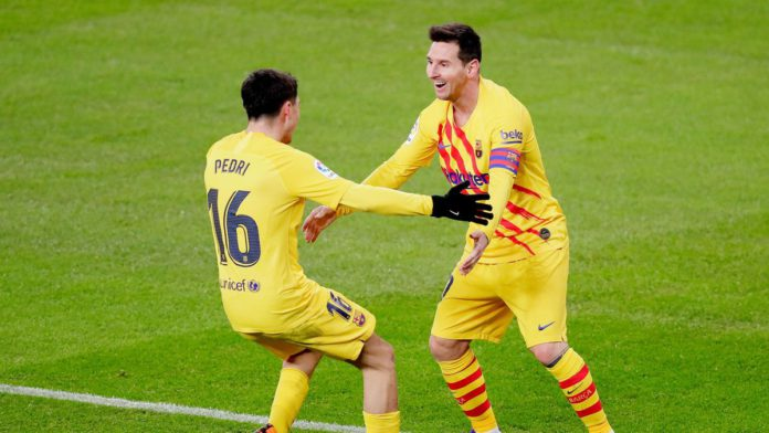 Lionel Messi of FC Barcelona celebrates 1-2 with Pedri of FC Barcelona during the La Liga Santander match between Athletic de Bilbao v FC Barcelona at the Estadio San Mames on January 6, 2021 in Bilbao Spain Image credit: Getty Images