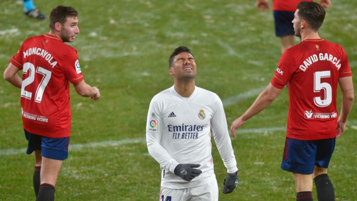 Real Madrid's Brazilian midfielder Casemiro (C) reacts after missing a goal opportunity during the Spanish League football match between Osasuna and Real Madrid at the El Sadar stadium in Pamplona on January 9, 2021. Image credit: Getty Images