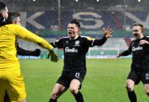 Holstein Kiel feiert die Pokal-Sensation gegen den FC Bayern Image credit: Getty Images