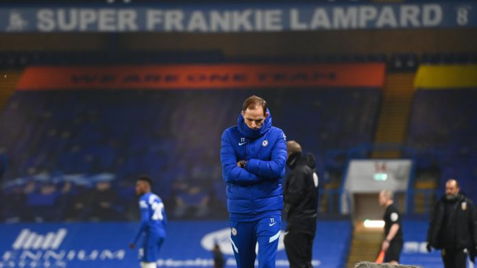 Thomas Tuchel the head coach / manager of Chelsea looks on with a banner for former head coach / manager Frank Lampard above him during the Premier League match between Chelsea and Wolverhampton Wanderers at Stamford Bridge on January 27, 2021 in London, Image credit: Getty Images