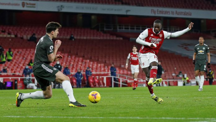 Manchester United's English defender Harry Maguire (L) blocks a shot from Arsenal's French-born Ivorian midfielder Nicolas Pepe during the English Premier League football match between Arsenal and Manchester United at the Emirates Stadium in London on Jan Image credit: Getty Images