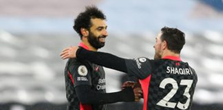 Mohamed Salah of Liverpool celebrates scoring his side's second goal with team mate Xherdan Shaqiri during the Premier League match between West Ham United and Liverpool at London Stadium Image credit: Getty Images