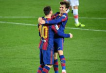 Barcelona's Argentinian forward Lionel Messi celebrates with Barcelona's Spanish midfielder Riqui Puig Image credit: Getty Images
