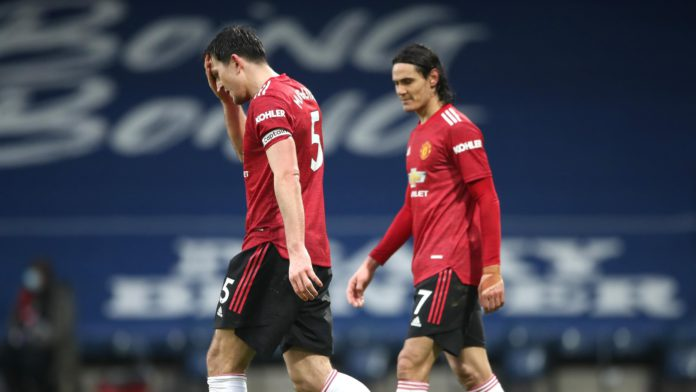 Harry Maguire, Edinson Cavani look dejected Image credit: Getty Images