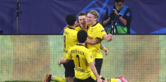 Erling Haaland (R) of Borussia Dortmund celebrates with Marco Reus and team mates after scoring their side's third goal during the UEFA Champions League Round of 16 match between Sevilla FC and Borussia Dortmund at Estadio Ramon Sanchez Pizjuan on Februa Image credit: Getty Images