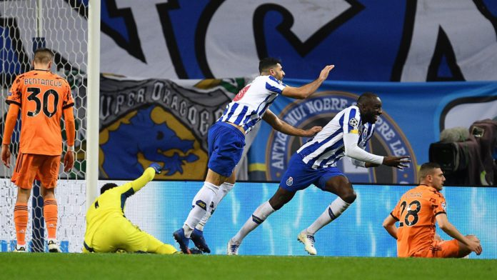 Moussa Marega of FC Porto celebrates with Mehdi Taremi after scoring his team's second goal during the UEFA Champions League Round of 16 match between FC Porto and Juventus at Estadio do Dragao on February 17, 2021 in Porto, Image credit: Getty Images