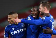 Gylfi Sigurdsson of Everton celebrates with teammates Richarlison and Abdoulaye Doucoure Image credit: Getty Images