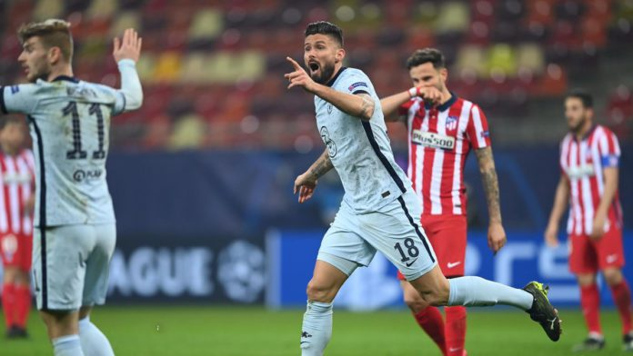 Olivier Giroud of Chelsea reacts as the flag goes up for offside. After a VAR deliberation the offside decision is overturned and Olivier Giroud scores their side's first goal during the UEFA Champions League Round of 16 match between Atletico Madrid and Image credit: Getty Images