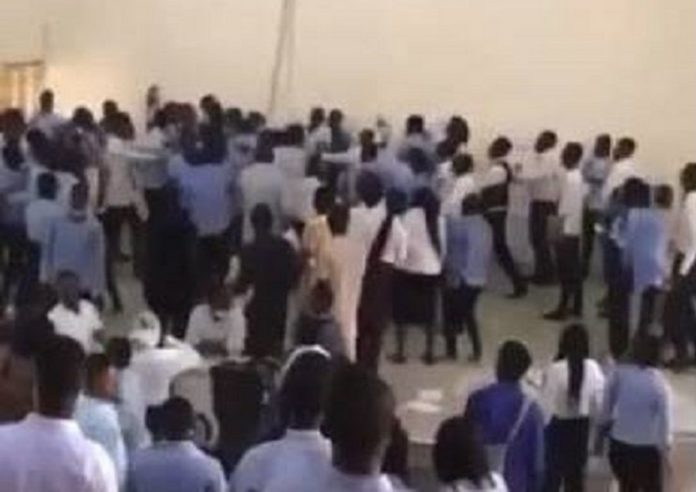 Embattled lecturer surrounded by angry students