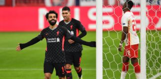 Mohamed Salah of Liverpool celebrates after scoring the first goal during the UEFA Champions League Round of 16 match between RB Leipzig and Liverpool FC at Puskas Arena on February 16, 2021 in Budapest, Hungary Image credit: Getty Images