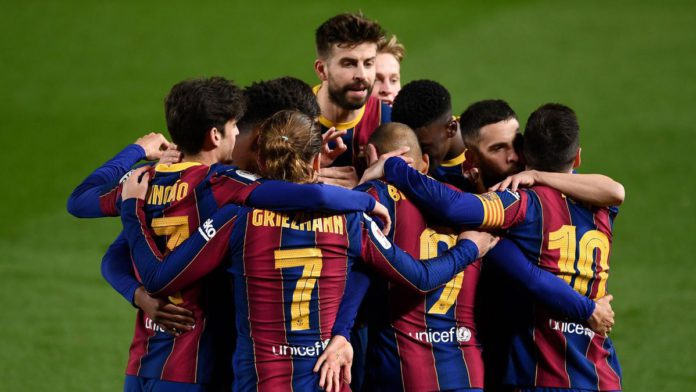 Barcelona players celebrate their third goal scored by Barcelona's Danish forward Martin Braithwaite during Spanish Copa del Rey (King's Cup) semi-final second leg football match between FC Barcelona and Sevilla FC at the Camp Nou stadium in Barcelona Image credit: Getty Images