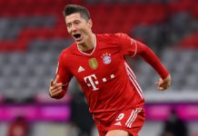 Robert Lewandowski of FC Bayern Muenchen celebrates after scoring their team's fourth goal, completing his hat-trick, during the Bundesliga match between FC Bayern Muenchen and Borussia Dortmund at Allianz Arena on March 06, 2021 in Munich, Germany. Image credit: Getty Images