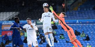 Rodrigo of Leeds United headers the ball, as Illan Meslier of Leeds United looks to punch Image credit: Getty Images