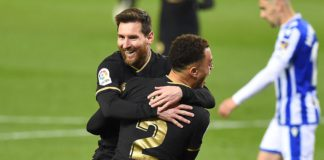 Barcelona's Barcelona's US defender Sergino Dest celebrates with Barcelona's Argentinian forward Lionel Messi (back) after scoring a goal during the Spanish League football match between Real Sociedad and Barcelona Image credit: Getty Images