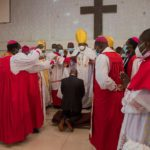 pastors surround Akufo-Addo as he kneels down for prayers