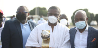 Sports Minister with U-20 Afcon trophy