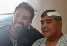 THIS HANDOUT PHOTO RELEASED BY THE PRESS OFFICER FOR DIEGO ARMANDO MARADONA SHOWS THE ARGENTINE FOOTBALL LEGEND SHAKING HANDS WITH HIS DOCTOR, LEOPOLDO LUQUE, AT THE OLIVOS CLINIC