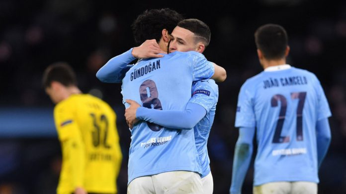 Manchester City's English midfielder Phil Foden (2R) celebrates scoring his team's second goal with Manchester City's German midfielder Ilkay Gundogan during the UEFA Champions League first leg quarter-final football match between Manchester City and Borussia Dortmund. Image credit: Getty Images