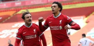 Liverpool's English defender Trent Alexander-Arnold (R) celebrates scoring his team's second goal during the English Premier League football match between Liverpool and Aston Villa at Anfield in Liverpool, north west England on April 10, 2021. Image credit: Getty Images