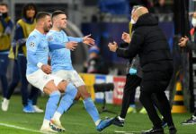 Phil Foden esulta abbracciando Pep Guardiola, Borussia Dortmund-Manchester City, Getty Images Image credit: Getty Images