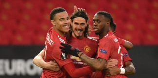 Manchester United's Uruguayan striker Edinson Cavani (C) celebrates with teammates after scoring the opening goal of the UEFA Europa league quarter final, second leg football match between Manchester United and Granada at Old Trafford Image credit: Getty Images