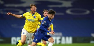 Kai Havertz of Chelsea runs with the ball under pressure from Dan Burn of Brighton and Hove Albion during the Premier League match between Chelsea and Brighton & Hove Albion at Stamford Bridge on April 20, 2021 in London, England Image credit: Getty Images