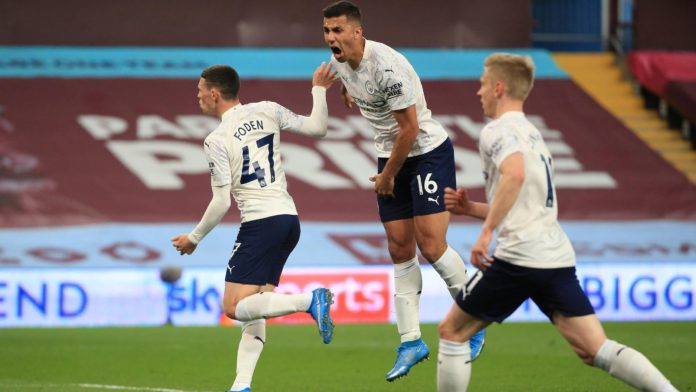 Phil Foden of Manchester City celebrates with Rodrigo after scoring their side's first goal during the Premier League match between Aston Villa and Manchester City at Villa Park on April 21, 2021 in Birmingham, England. Image credit: Getty Images
