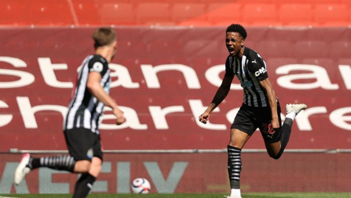 Joe Willock of Newcastle United celebrates after scoring their side's first goal during the Premier League match between Liverpool and Newcastle United at Anfield Image credit: Getty Images